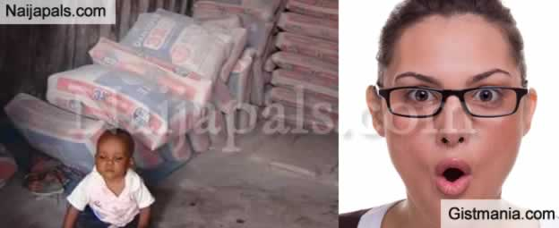 SHOCKING !!!:  See How Little Baby Narrowly Escapes Being Crushed By Bags Of Cement At A Shop In Lagos (Photos)