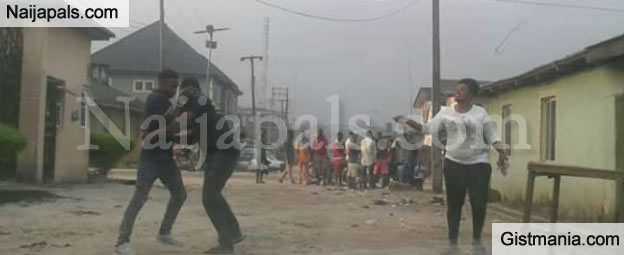 LORD !!!: Drama As Man Dishes Out Hot Slaps To His Girlfriend In Public For Seizing His Car Keys In Delta