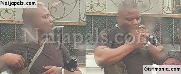 LORD !!!:  SARS Officer Spotted Smoking During Operation In Port-Harcourt (Photos)